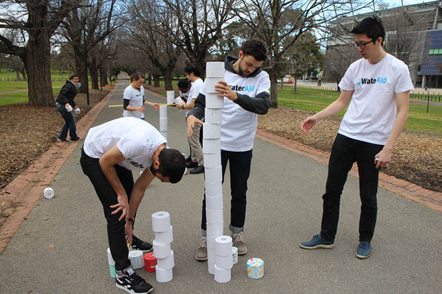 Another team building a toilet paper tower