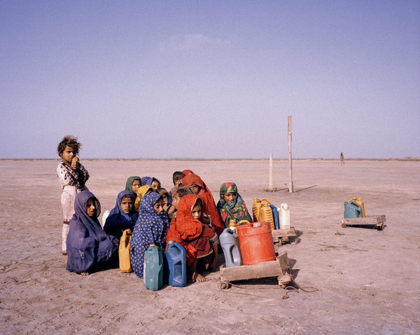 Children in the desert on their way to collect water in Pakistan