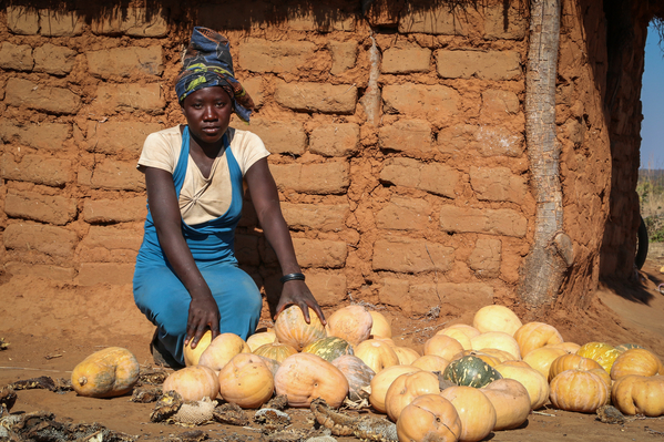 Maritha in front of her pumpkins in Malawi
