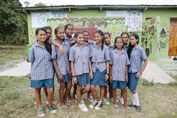 Schoolgirls in front of the toilet block in Timor-Leste