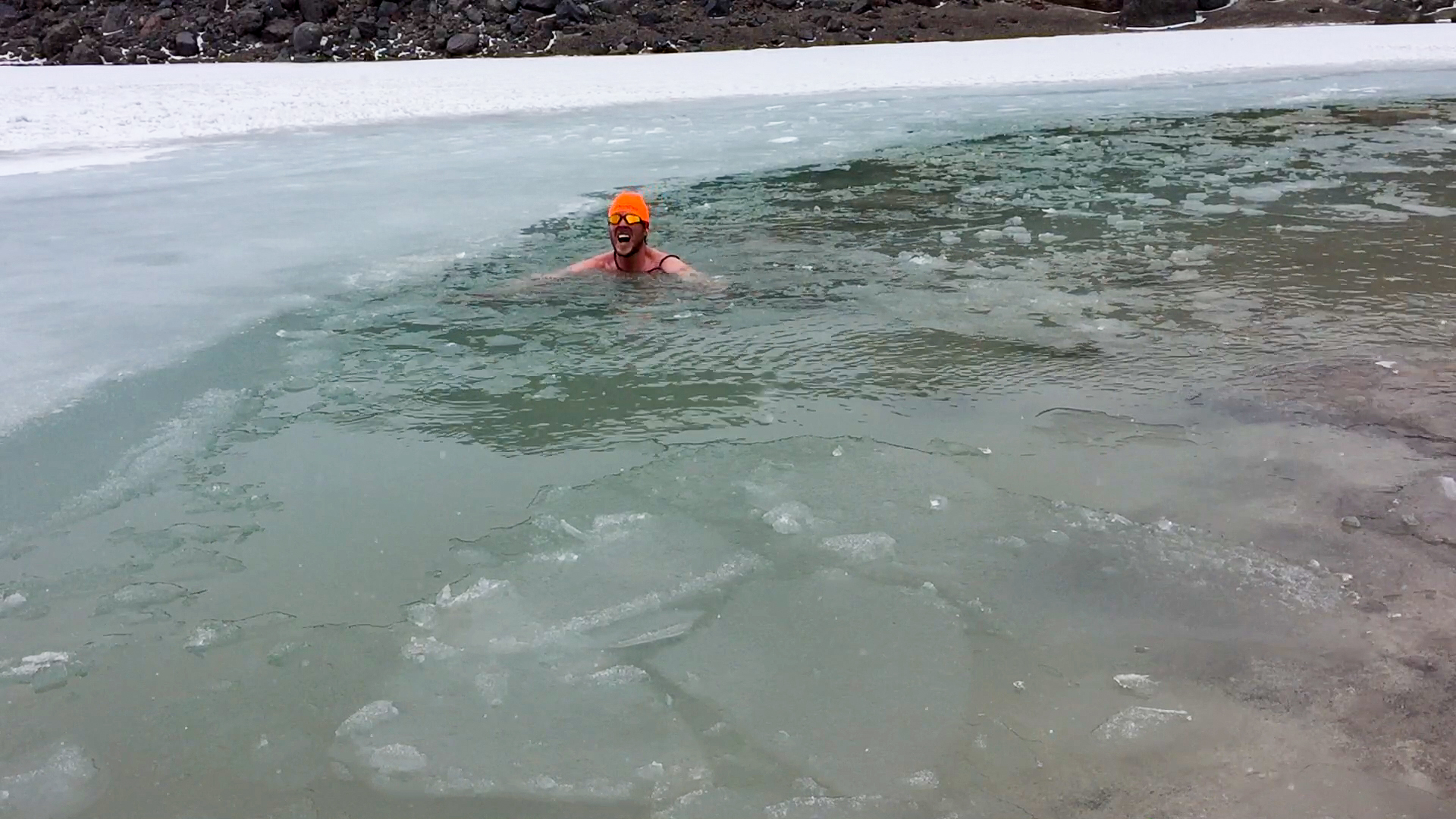 dan swimming in the frozen lake