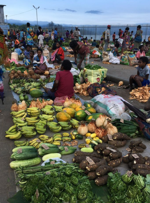 fruit and vegetables being sold at the local market