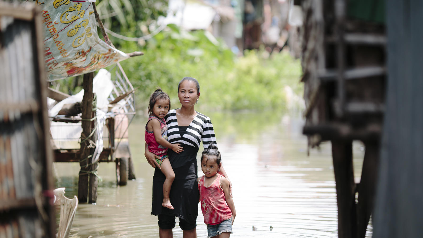 Chan Srey Nuch, 31, lives with her two young daughters  in the Chong Kaosou community, Siem Reap, Cambodia. Srey Nuch fears that her children could drown in filthy flood water when she is out working.