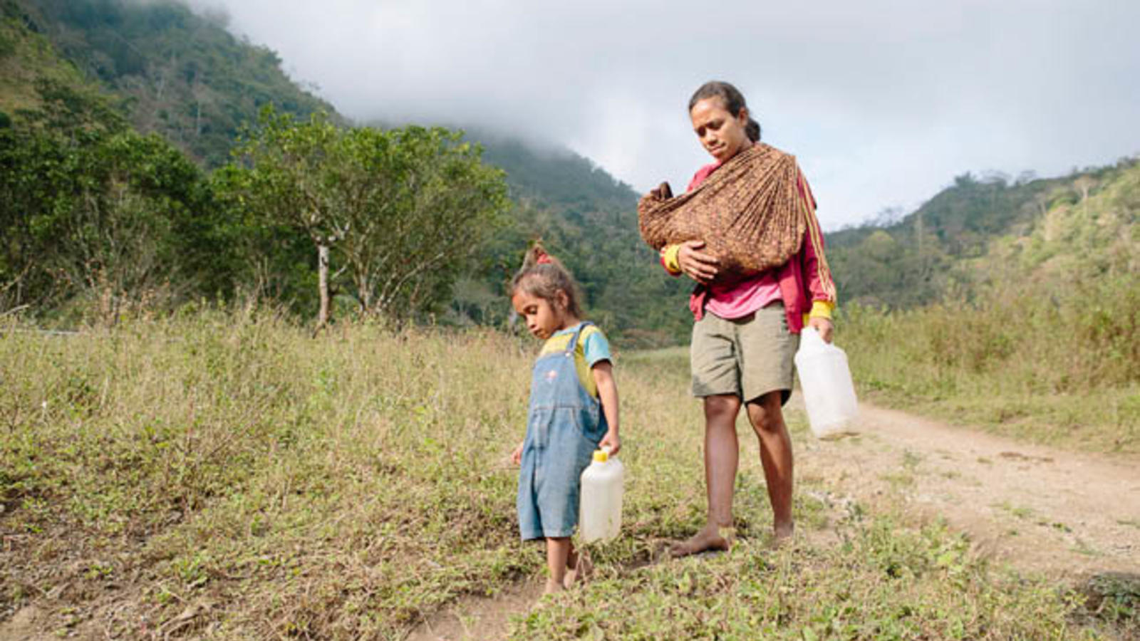 Mother and child fetching water