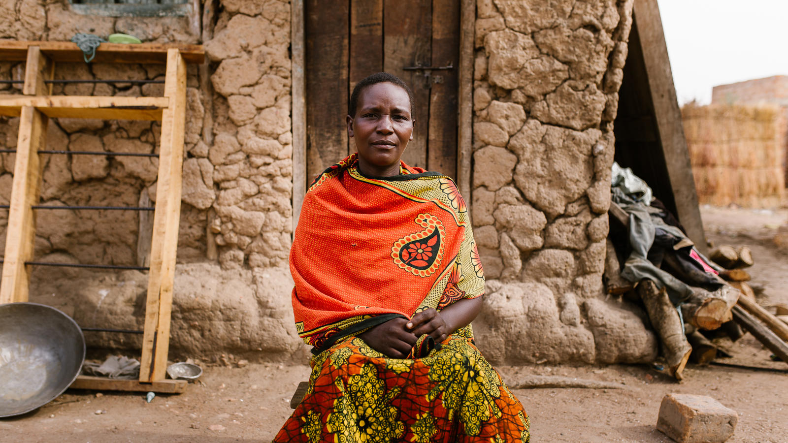 Salome Elias 39, shown at home in Nyarugusu. Her eighth child, a baby girl she called Margaret, died of fever and suspected infection on her third day of life. Nyarugusu, Geita district, Tanzania, September 2017.