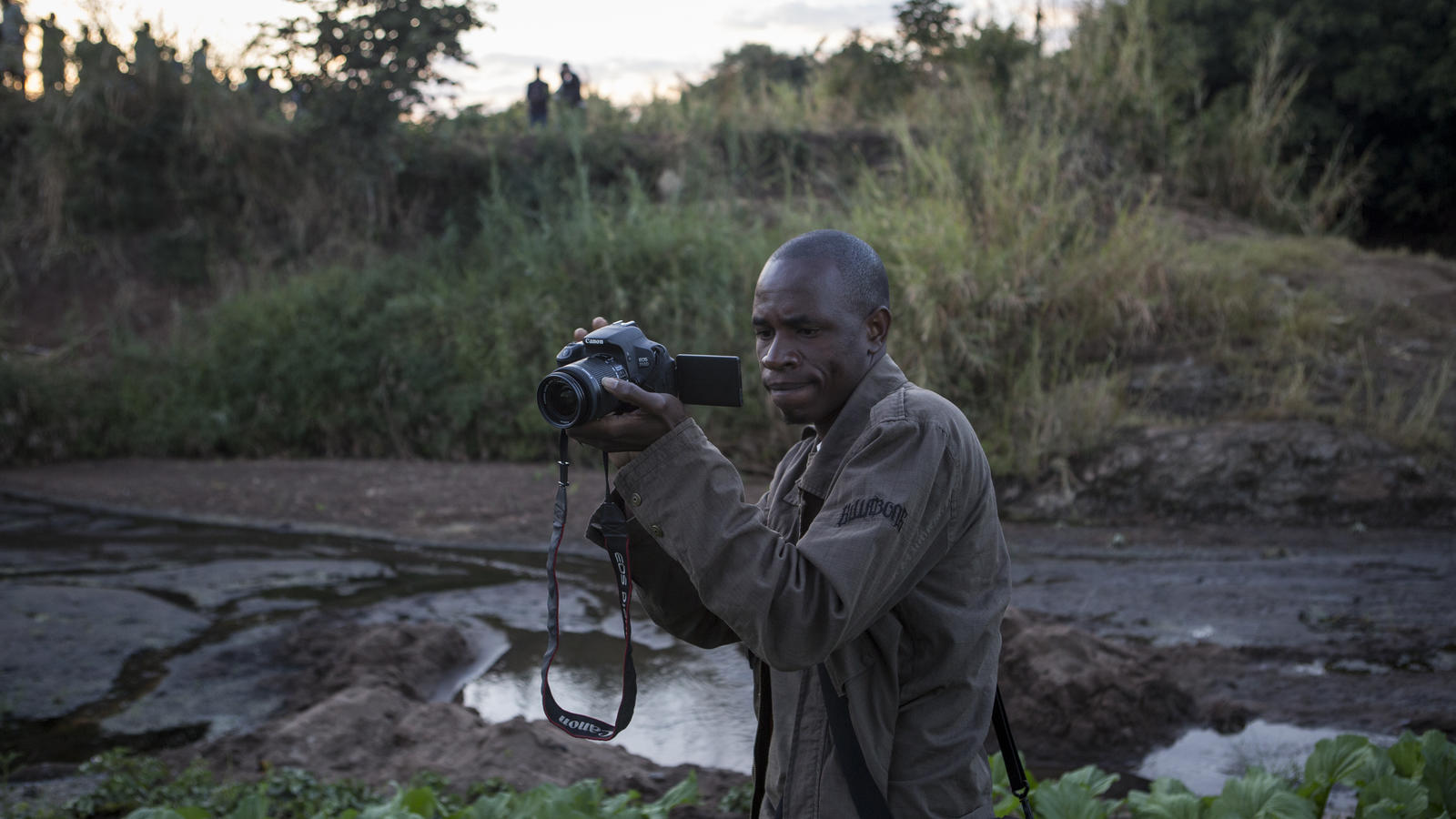 Our Voices from the Field officer Dennis, with a camera.