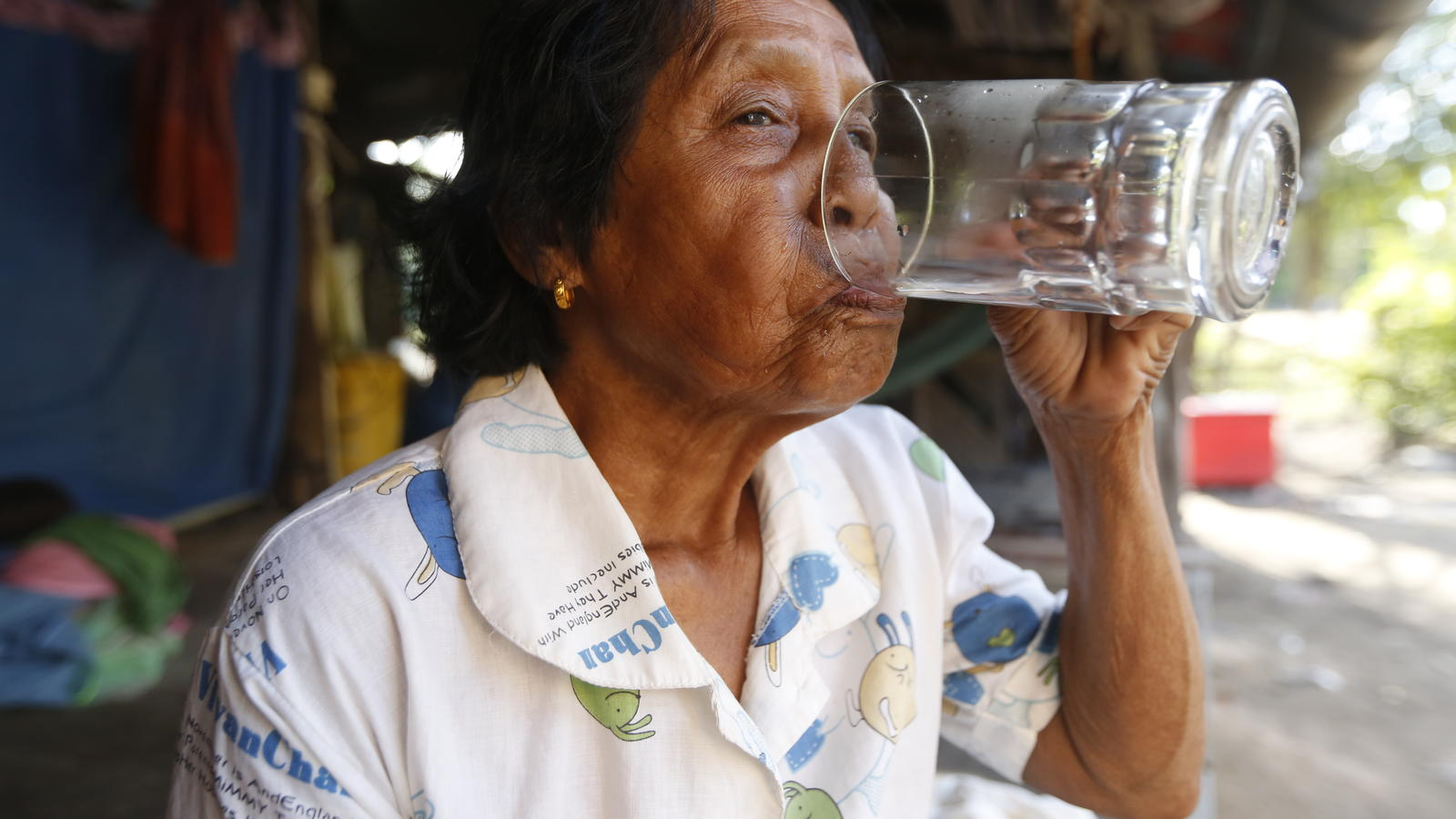 a woman drinking clean, safe water