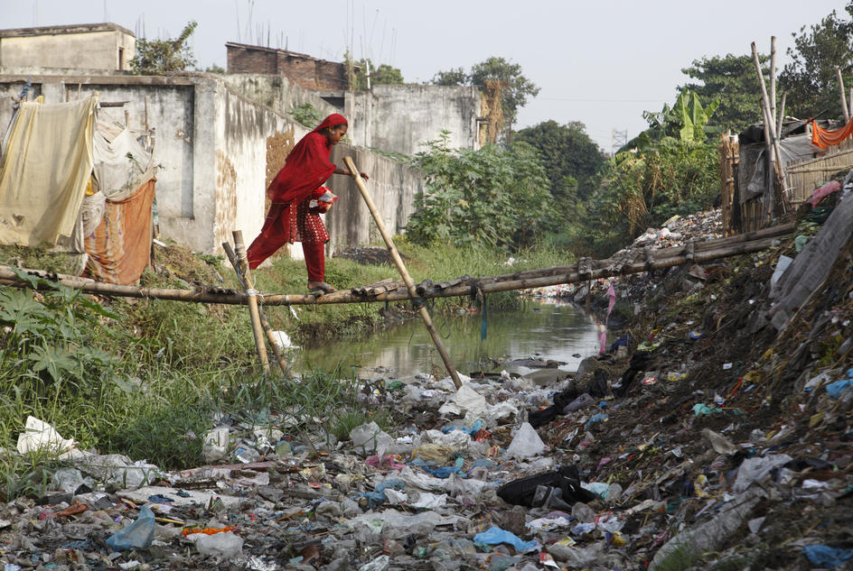 This bridge joins two areas of the community together.  The banks are oftern used as a dumping ground for waste, and if people have constructed their own make-shift toilets, quite often they are situated along the banks, where children often play, Kamla Nehru Nagar, India.