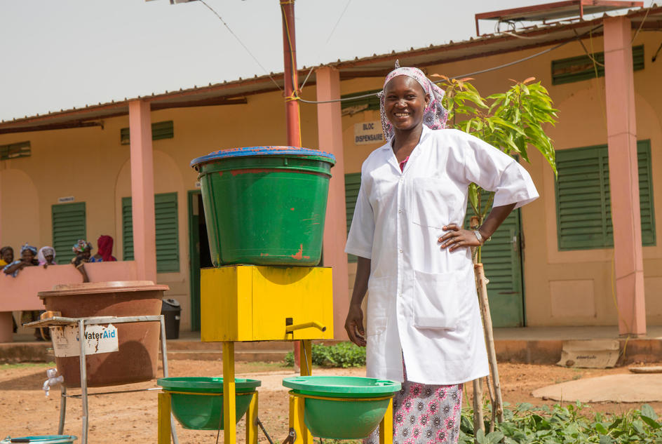 Korotimi Dembele, Pharmacy Manager, next to a handwashing device in front of the community clinic block in Bougoura Communal Health Centre, Bougoura Village, Commune of Yangasso, Circle of Bla, Region of Segou, Mali. May 2017.