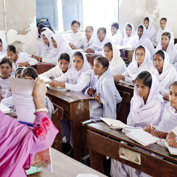 Students listen during a menstral hygiene matters session, Government High School, Mithi, Pakistan, 2013