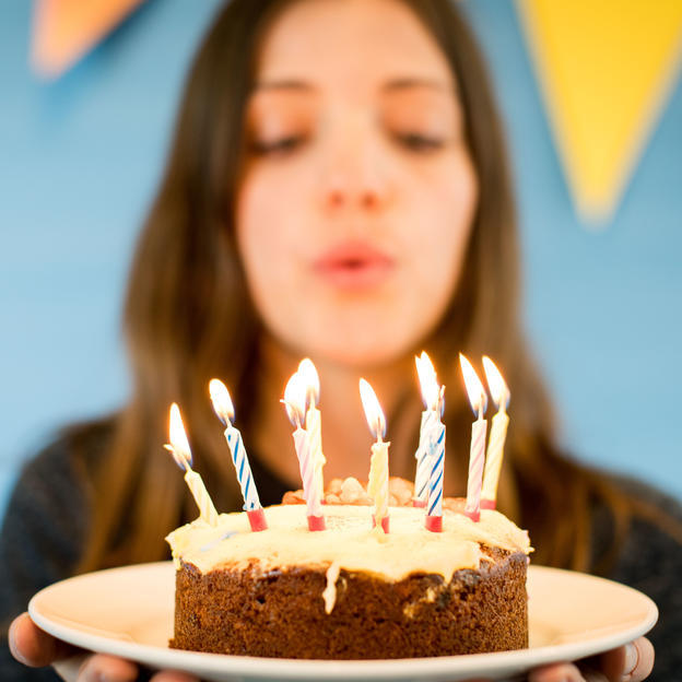 Girl blowing candles on cake