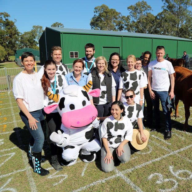 WaterAid Australia Chief Executve Rosie Wheen,with Seqwater Innovators at Cow Poo Lotto