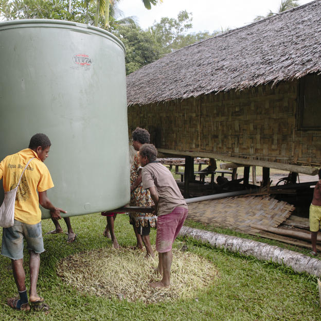 PNG men installing a water tank