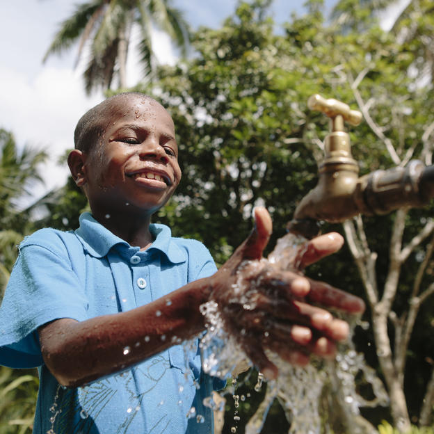 PNG kid washing his hands at a tapstand