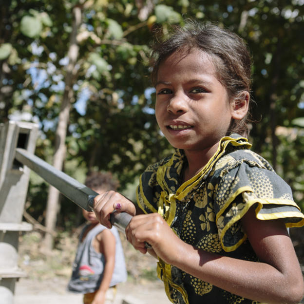 Timor-Leste child using a handpump
