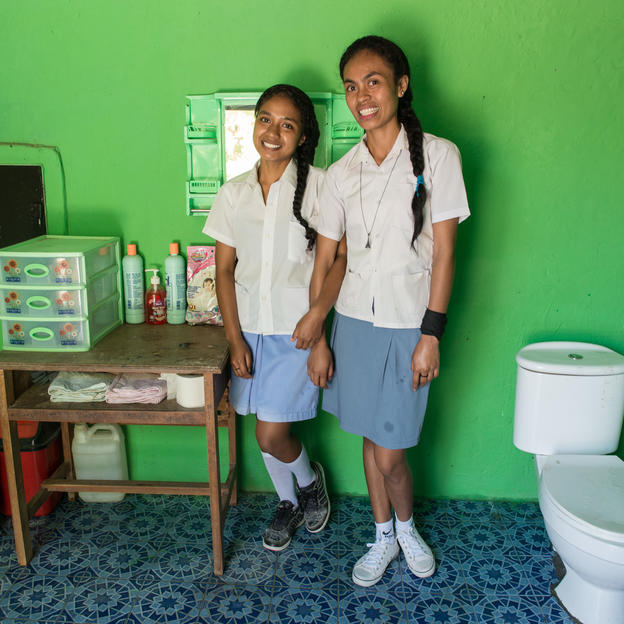 Two school girls in the school toilet