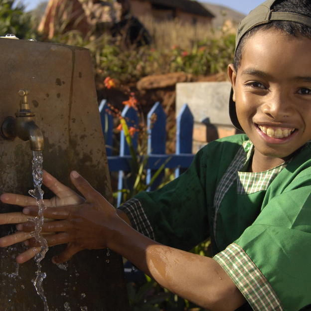 Dona, washing his hands at the water point,  Ankafotra school, Mahaiza Province, Madagascar