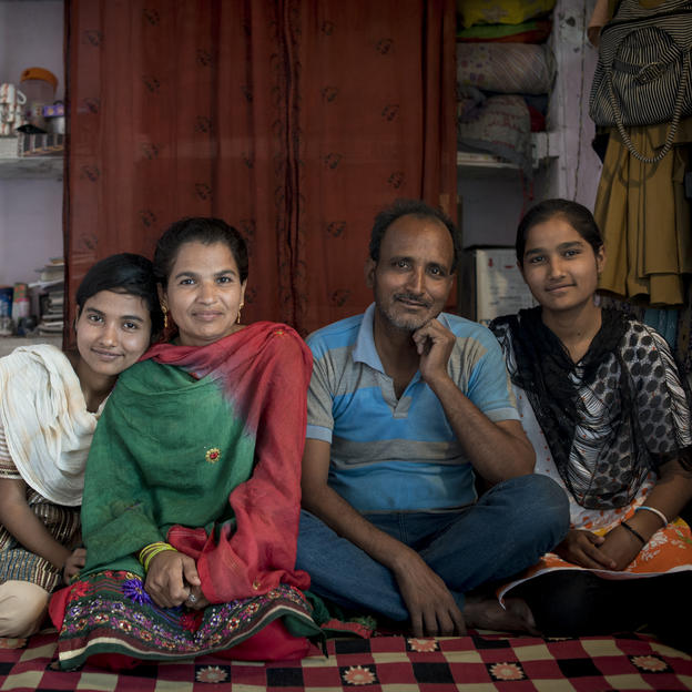 Seema Khatun, 35, a shopkeeper, with her husband Mohd Tariq, 40, and their daughters Sania, 16, and Neha, 19, at their home in Rasoolpur Sadat, Uttar Pradesh, India, 5 April 2014.