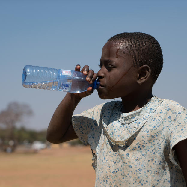 Madalitso, quenching her thirst with potable water in Lilongwe, Malawi, September 2016.