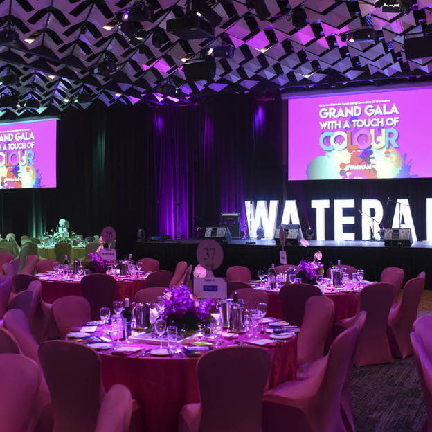 A large ballroom set up for one of WaterAid's Gala Balls