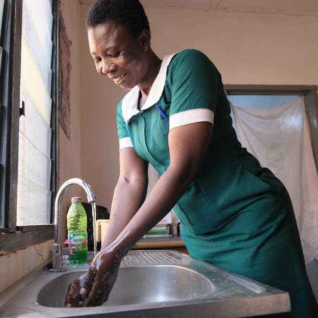 A midwife washing her hands