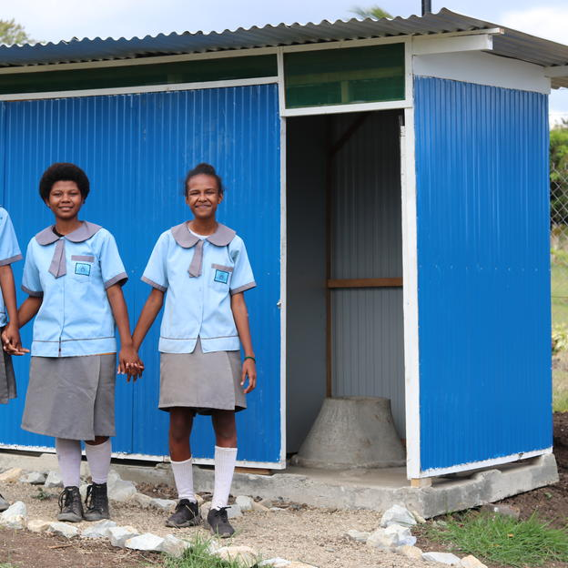 Girls in Papua New Guinea outside their new toilets