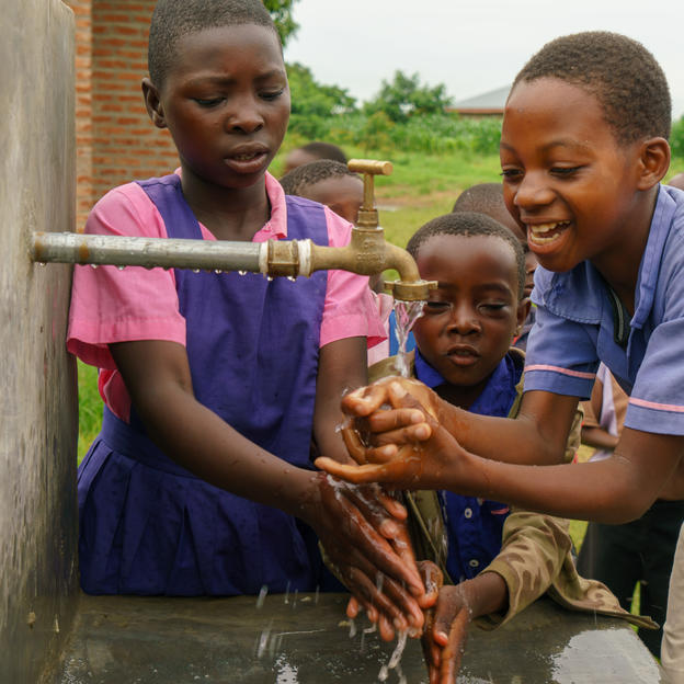 Students washing their hands at Kavunguti Primary School, Kasungu, Malawi