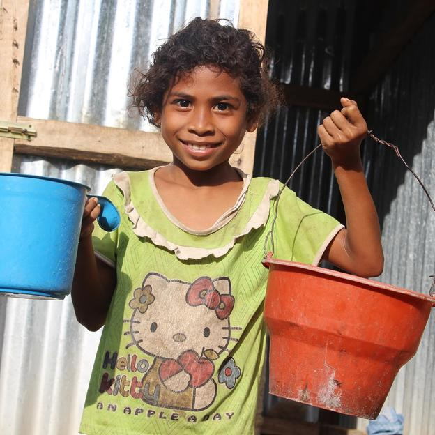 Timor-Leste girls holds buckets of water