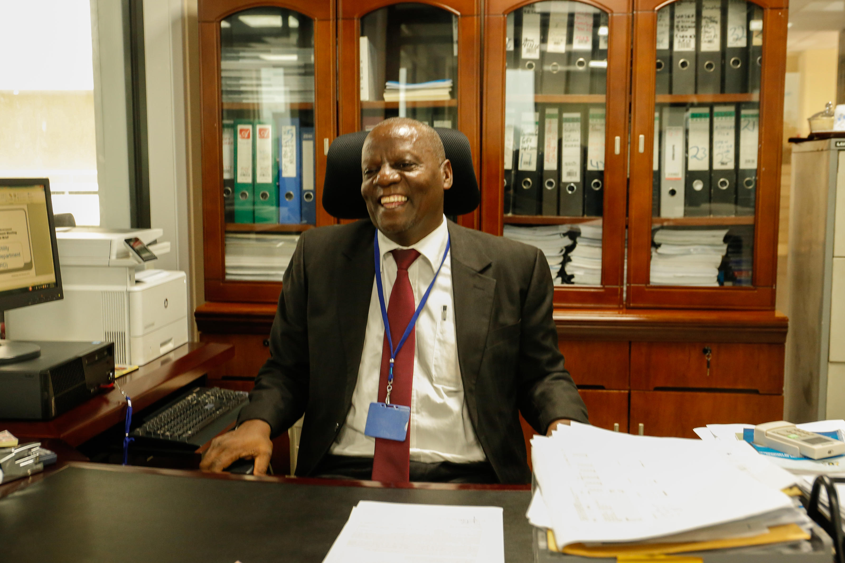 Tumusiime Christopher, Acting Commissioner for Regulation in the Department of Water Regulation in his office at the Ministry of Water and Environment, Luzira, Kampala, Uganda, February, 2019.