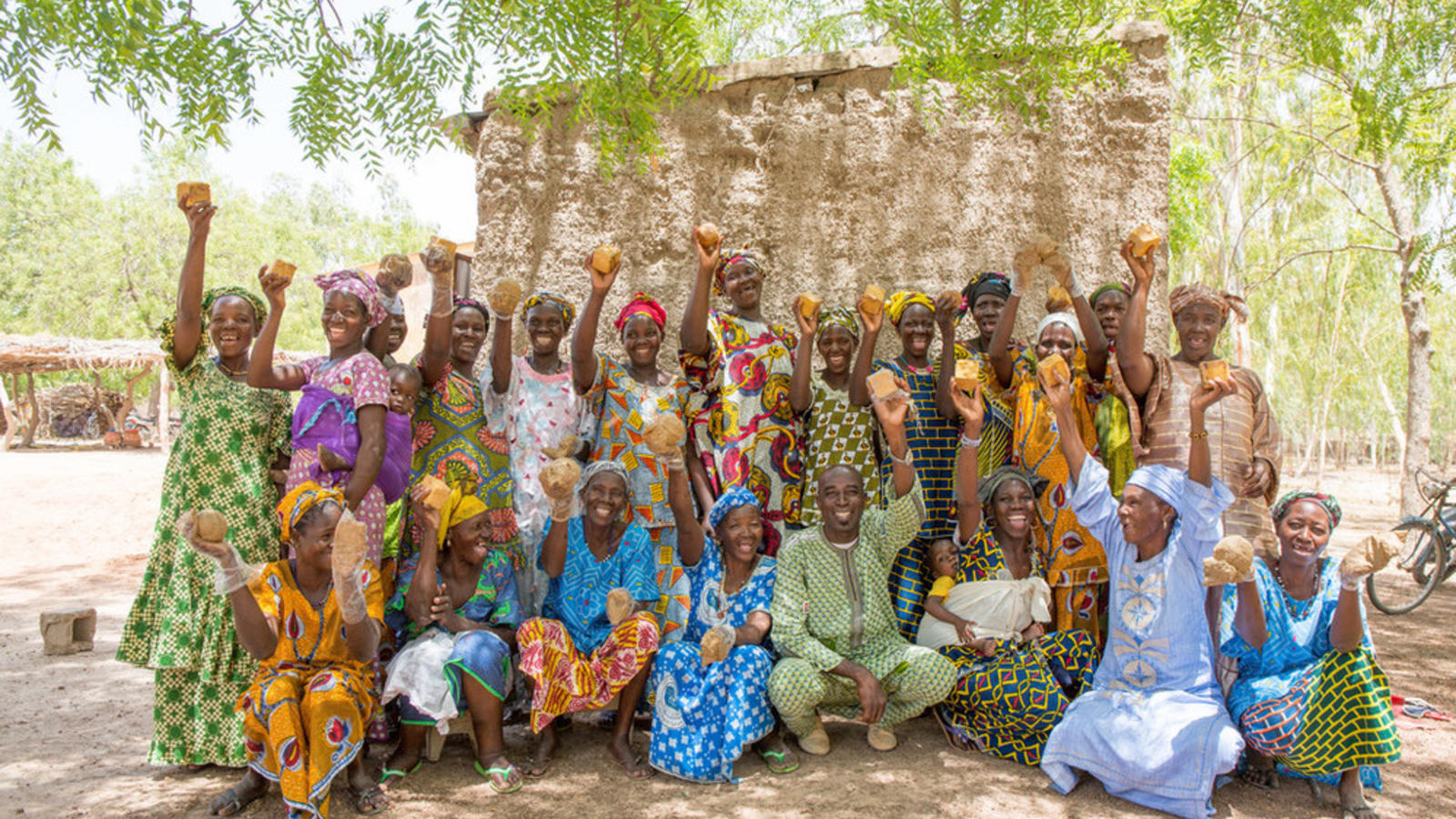 A village in Mali celebrates that they have access to clean water by posing for a picture.