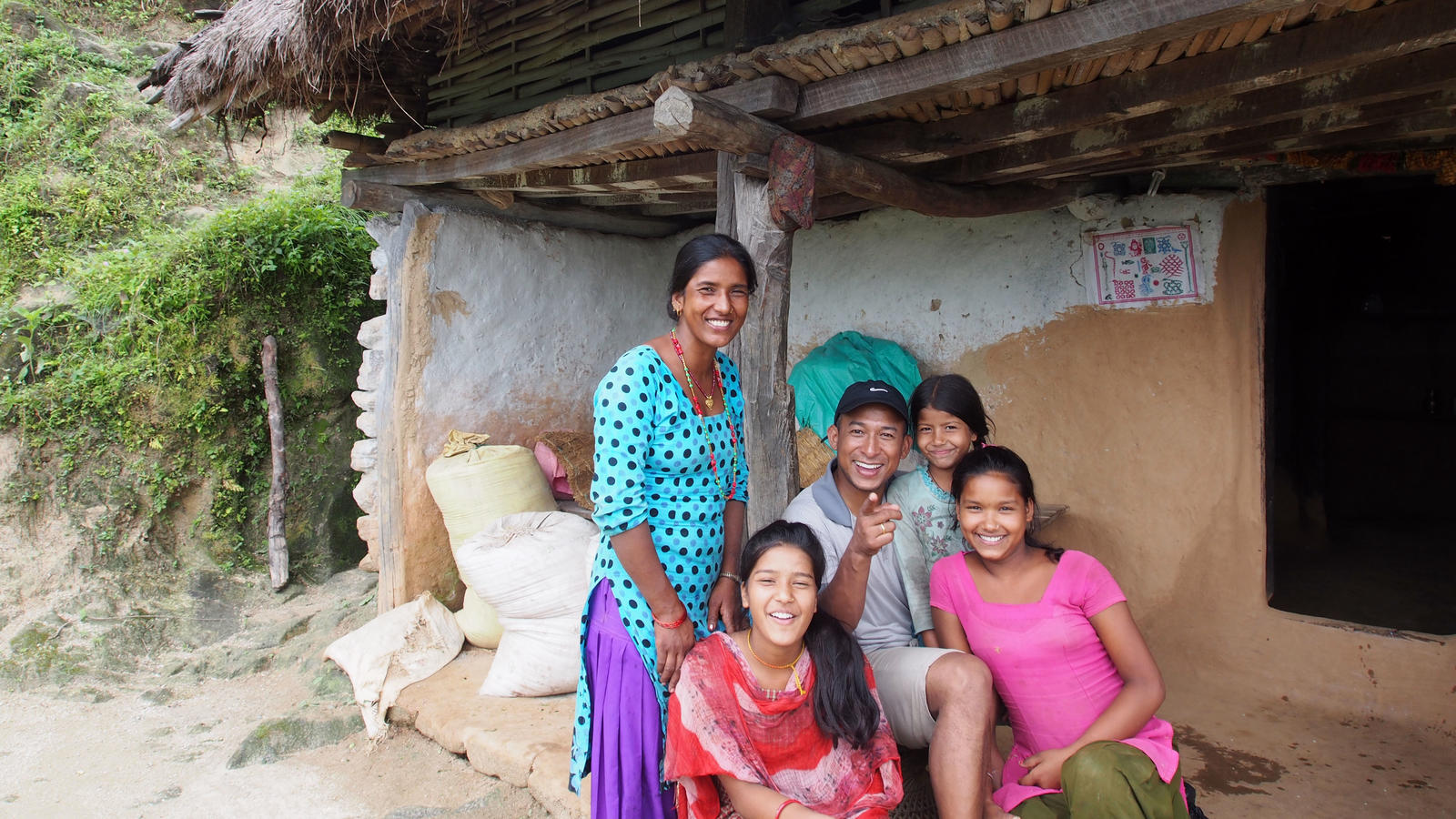 Our Voices from the Field officer Mani, with Balkumari's family in Nepal.