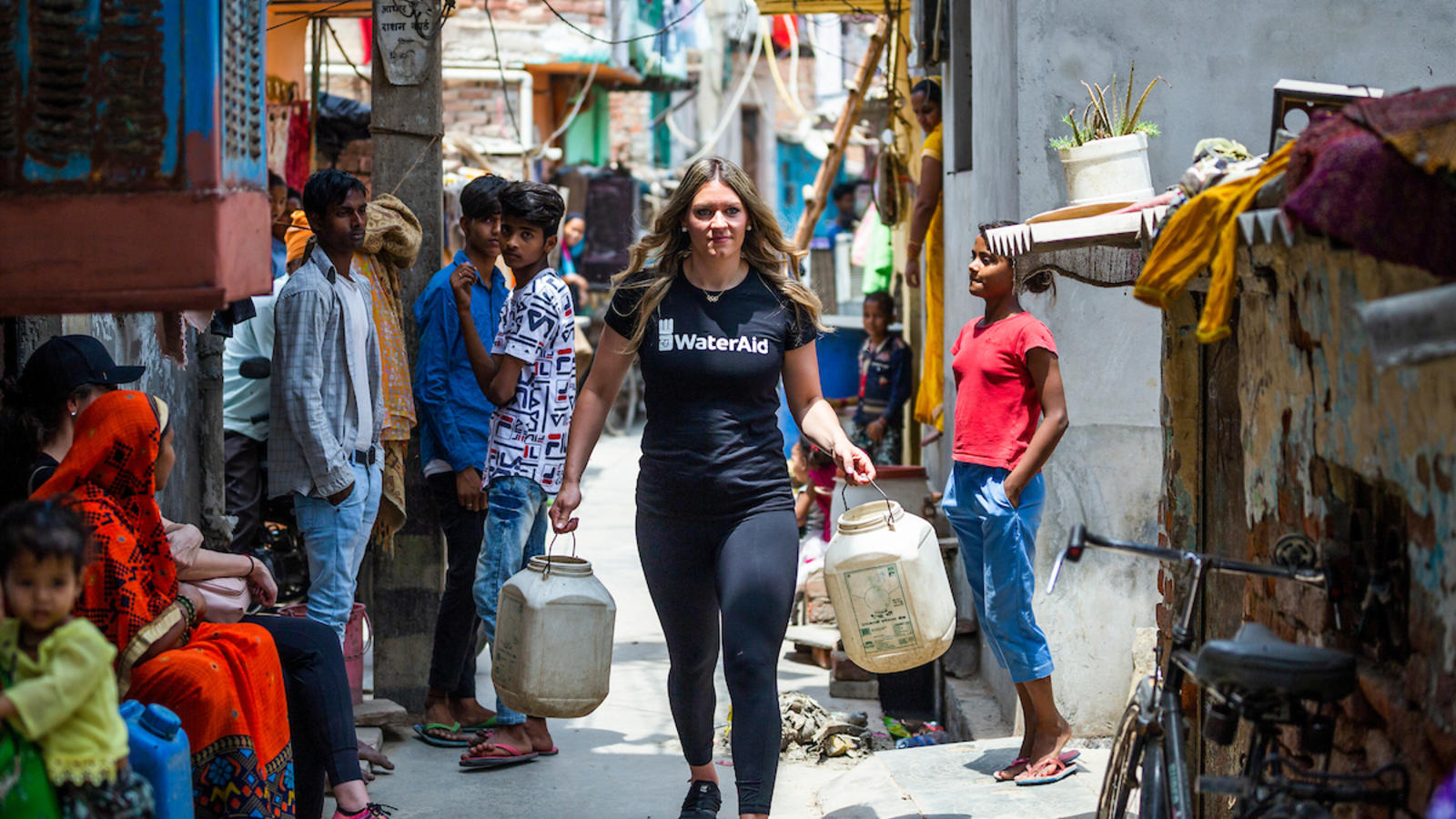 Natalie visiting an urban slum in New Delhi that has limited access to water.