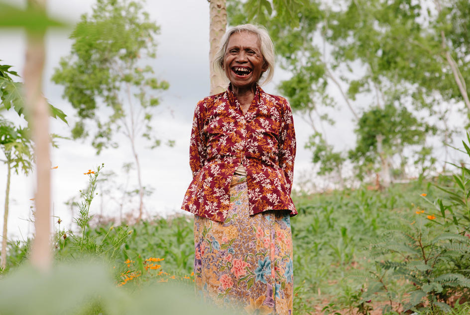 Alzira waters her garden in Timor Leste.