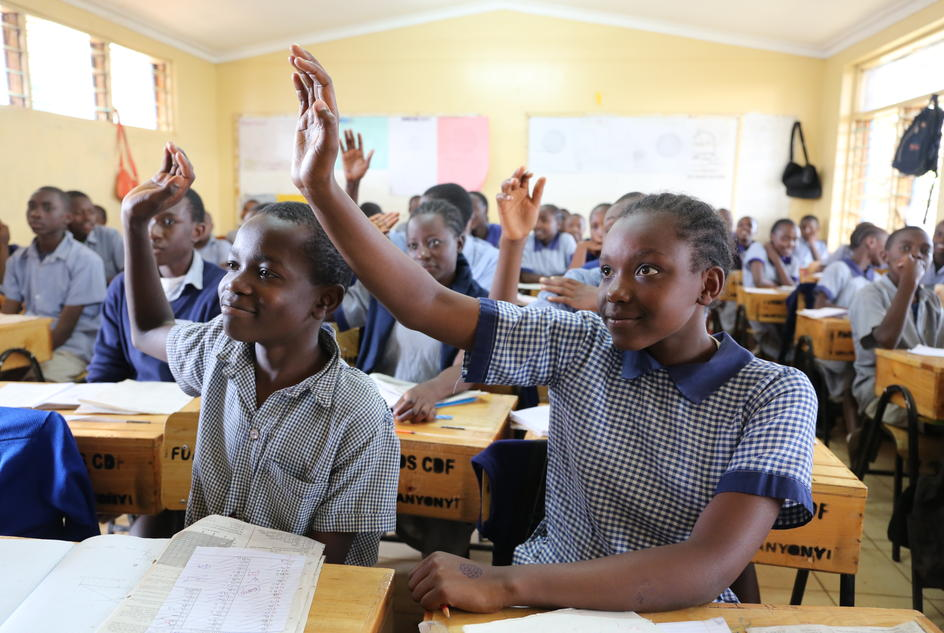 Brenda, an eighth grade student and senior member of the health club raises her hand in class at Kangemi Primary School, Kenya.