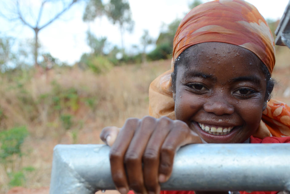 Solo smiles after clean water arrives in her village in Madagascar.