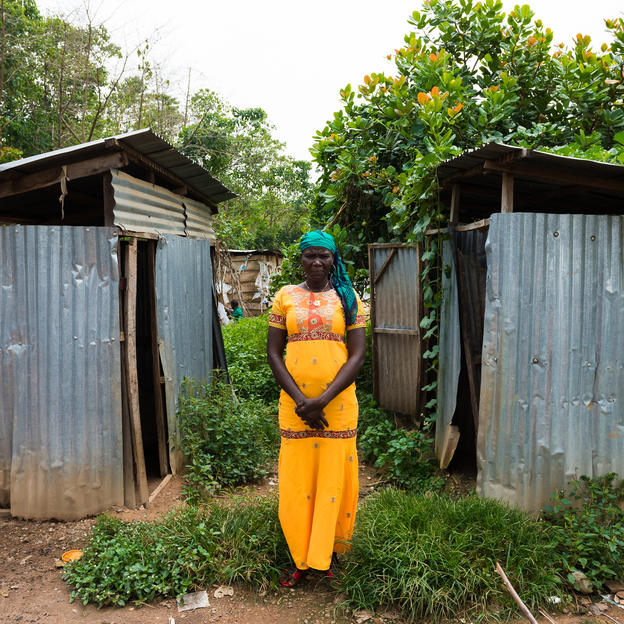 "Ladi Mathias, 36, Women leader (Kuchingoro IDP camp) was displaced by the Boko Haram crisis and now lives in Kuchingoro IDP camp in Abuja, Nigeria. She is standing by the public toilets that are out of order and is now forced to use the bush: ""It's not a great situation to defecate in the bush. At night, it's quite scary."""