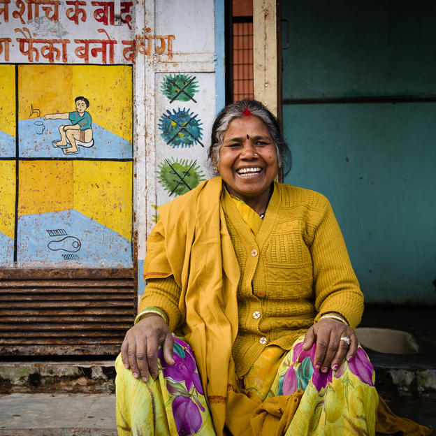 Community toilet caretaker Chanda sits outside the toilets in Delhi, India.