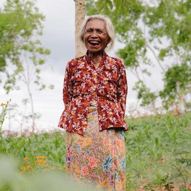 Alzira waters her garden in Timor-Leste.