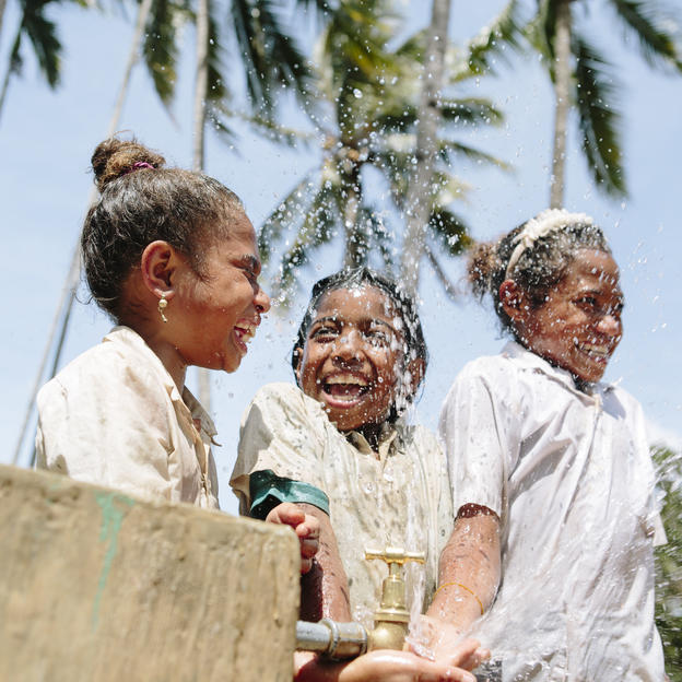 Fatima, Lourdes and Amelia play together at a new tap stand in Timor-Leste.