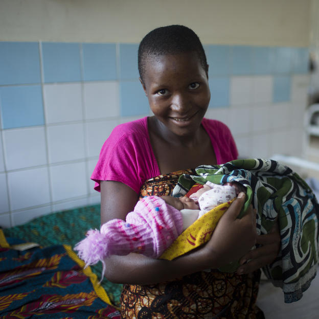 Christina Emmanuel, 18, holding her three day old baby, who was delivered by caesarian section, at Kiomboi Hospital, Iramba, Tanzania, June 2015.