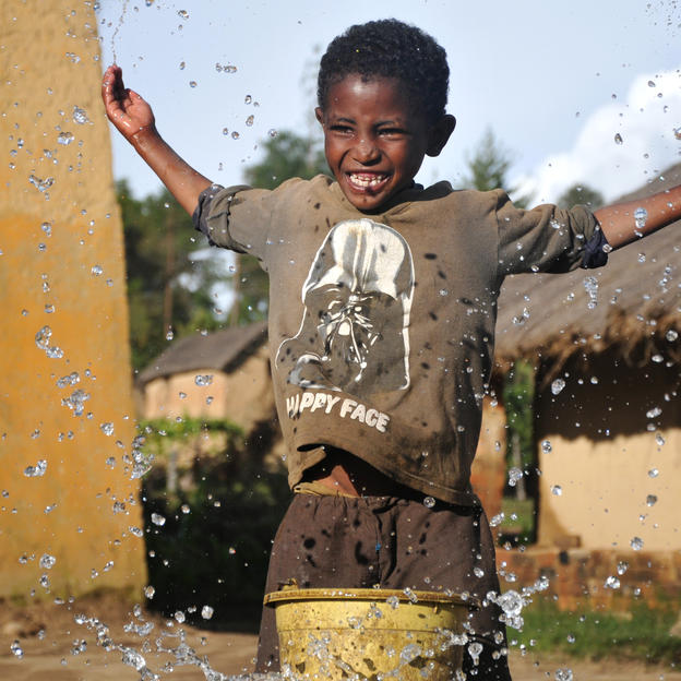 Nomena splashes with clean water in Madagascar.