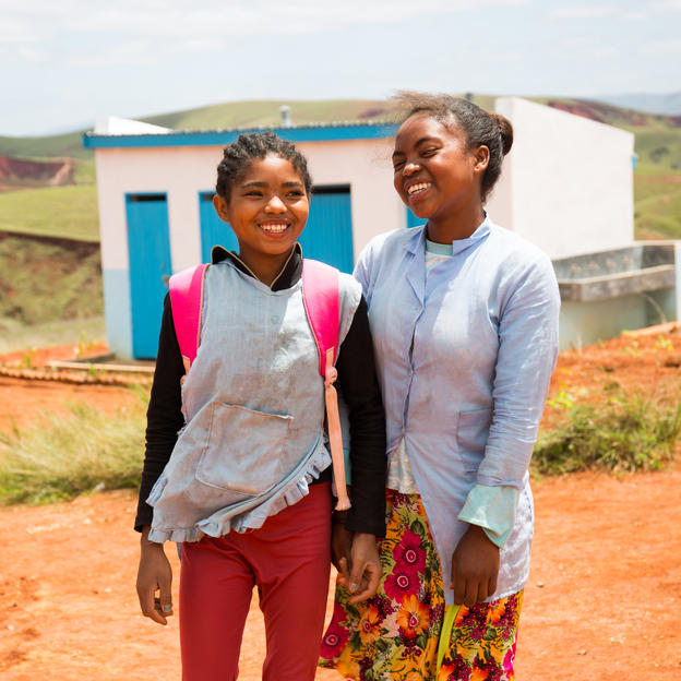 """Before, fetching water for our school was tough, now we don't have to worry about water and toilet in our school anymore."" (L-R) Rebecca, 13, and Narindra, 14, in front of their newly built toilet block, at Antakavana Secondary School, Antakavana Commune, Ankazobe District, Madagascar. January 2018."