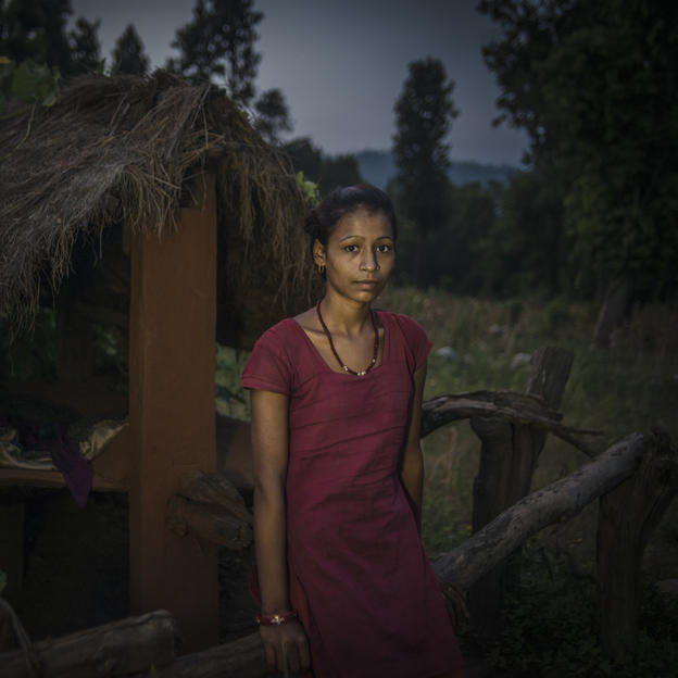 Radha Bishwa Karma, 16, standing outside the chhaupadi hut at night.