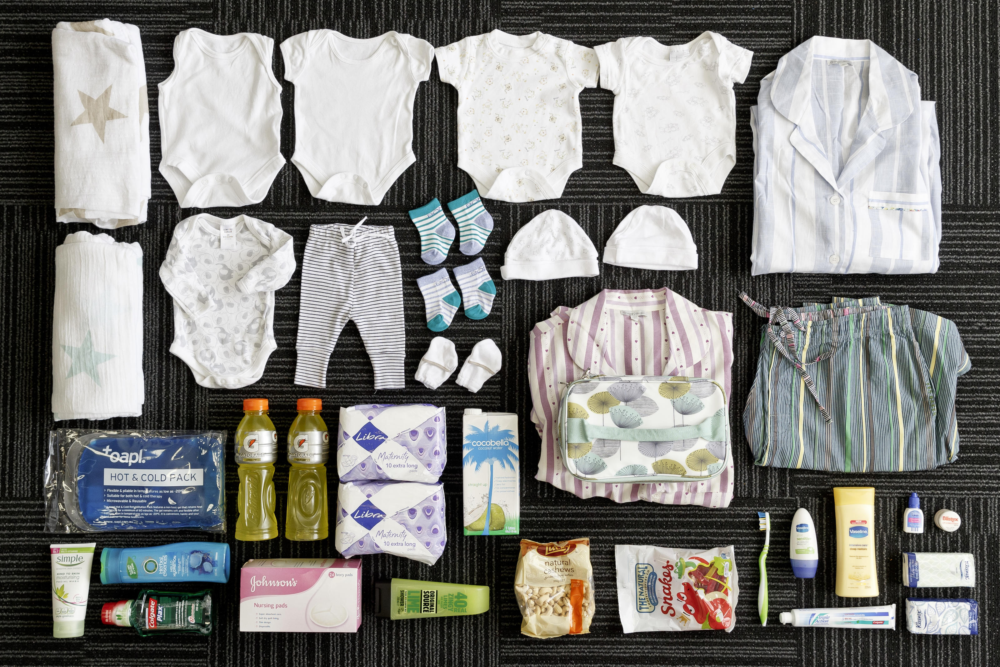 Katy Shaw's, 31, maternity bags contents: toileteries, snacks, nappies, het, socks, mittens, clothes and swaddles for the baby, clothes for her, night dresses, maternity underwear, maternity pads nursing pads, massage oils. Melbourne, Australia, 2015.