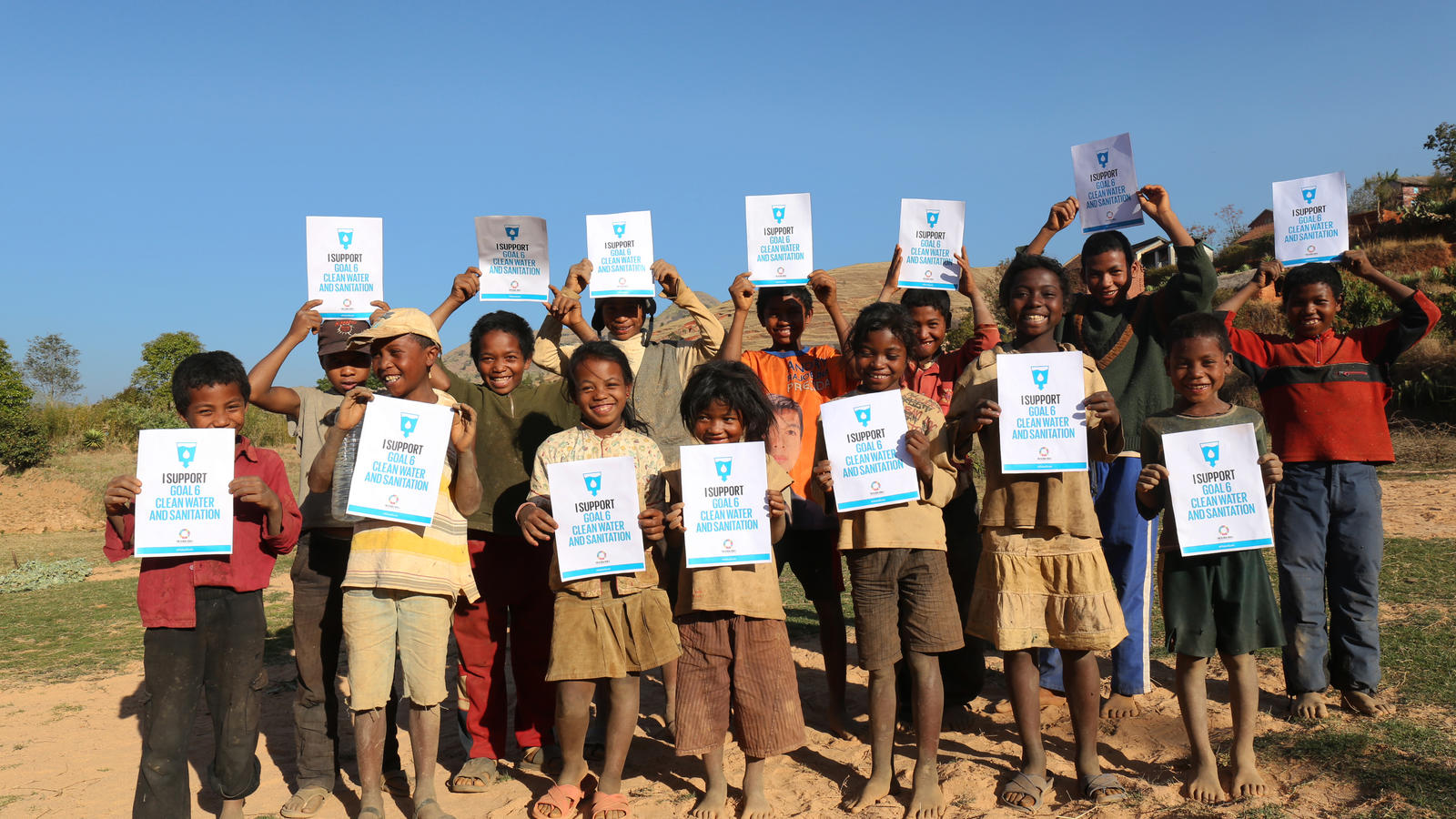 A group of children from Ampilanonana village supporting Global Goal six 'Clean water and sanitation'. Ampilanonana commune, Betafo district, Vakinankaratra region, Madagascar. September 2015.