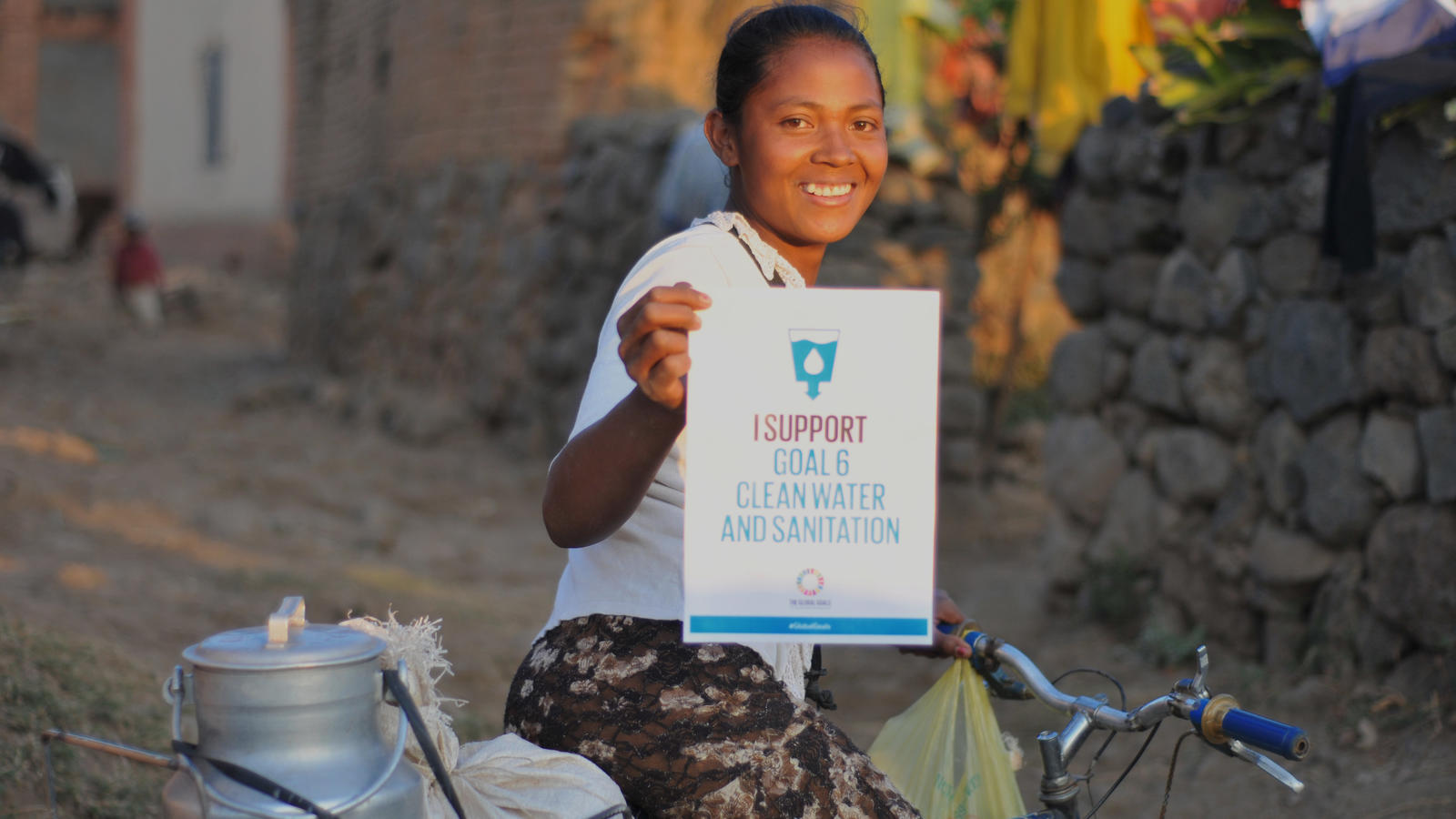 "Laza, 23 years old, supporting Global Goal six 'Clean water and sanitation."" Ambohitrinilahy village, Vakinankaratra region, Madagascar. September 2015."