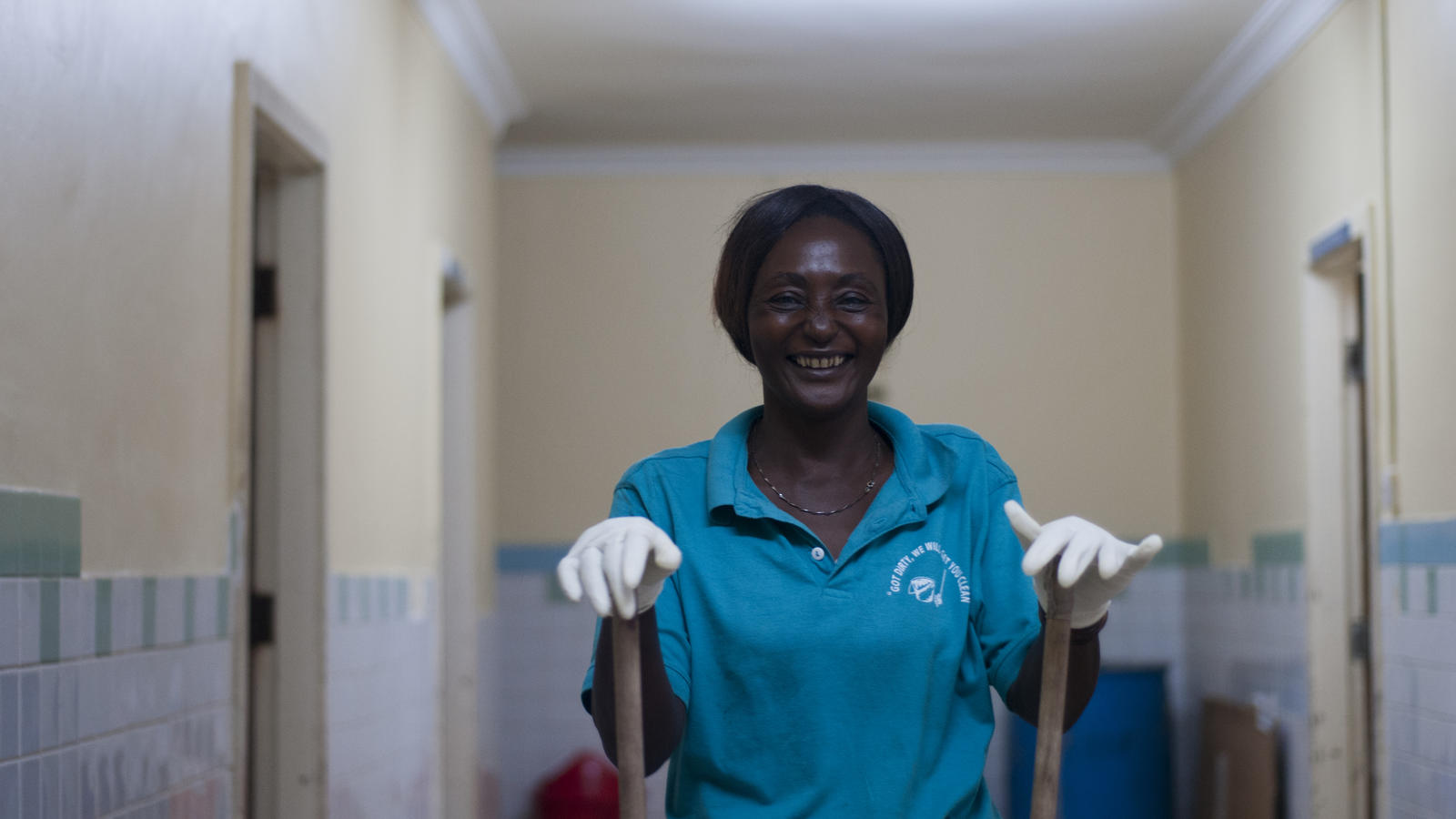 """As a cleaner, having enough running water here is really helping me because when I get to my job I am not looking for water anymore, just turning on the tap and getting my water, so my job is becoming easy."" Cleaner Margaret Edson working at the labour ward. Kiomboi Hospital, Iramba, Tanzania, January 2016."