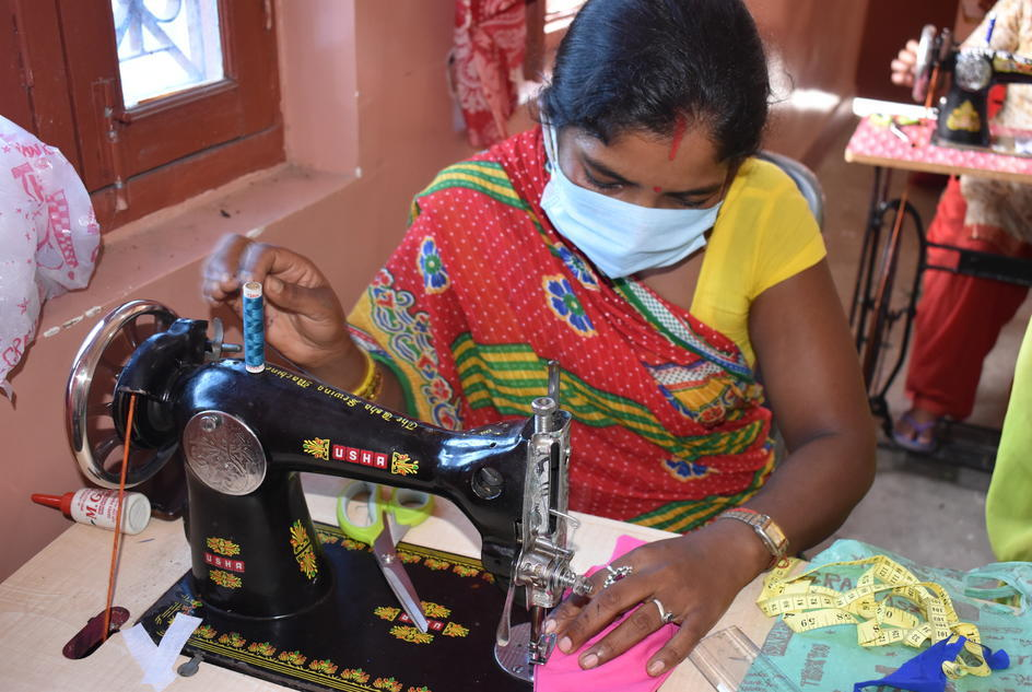 a-woman-learns-how-to-make-a-face-mask-as-part-of-wateraid-nepals-work-across-golbazar-municipality-and-siraha-district-to-provide-people-with-support-to-start-up-their-own-enterprises