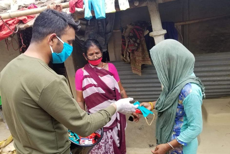 a-woman-receives-a-face-mask-from-wateraid-nepal-as-part-of-its-covid-19-response