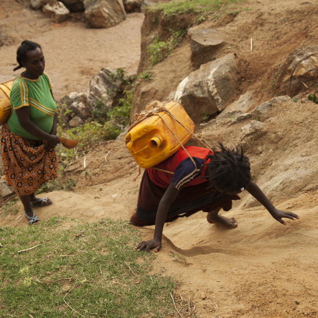 Etalem Tinishu and her daughter carry jerrycans full of dirty water back home, Lahyte, Konso, Ethiopia, 2012.